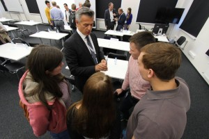 Mentor Novica Mrdovic talks to students following the pitch sessions on Tuesday.