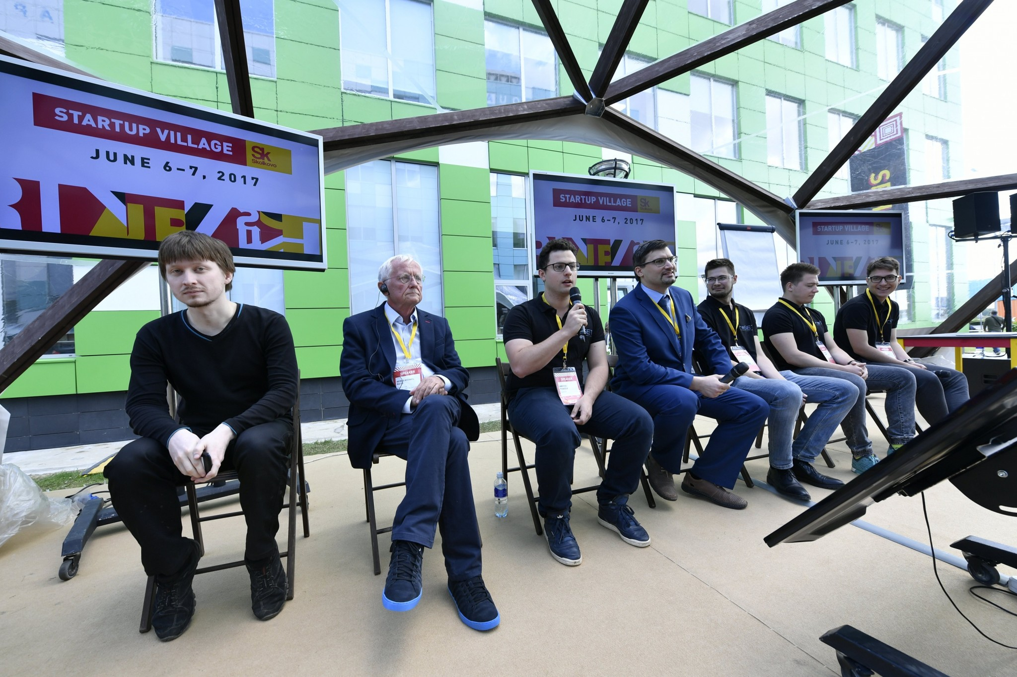 Members of Skoltech's award-winning robotics team reSET and renowned Artificial Intelligence expert Professor Bernd Radig of the Technical University of Munich (second from left) participate in a robotics panel at the Startup Village.