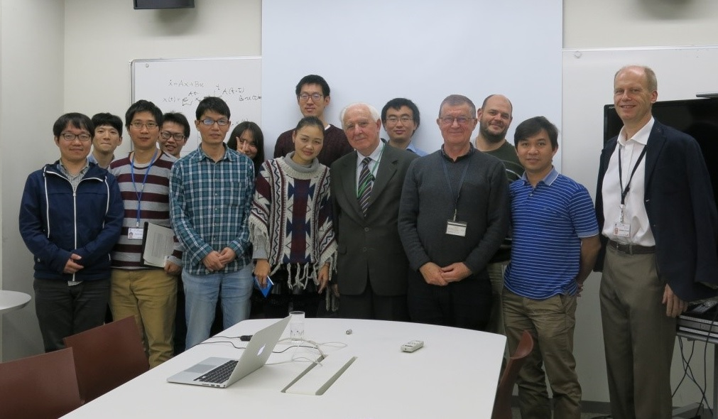 Cichocki (third from the right) and one of his research teams at RIKEN, pictured in 2016