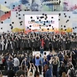 Skoltech graduates and faculty members toss their graduation caps in the air after the 2017 commencement ceremony.