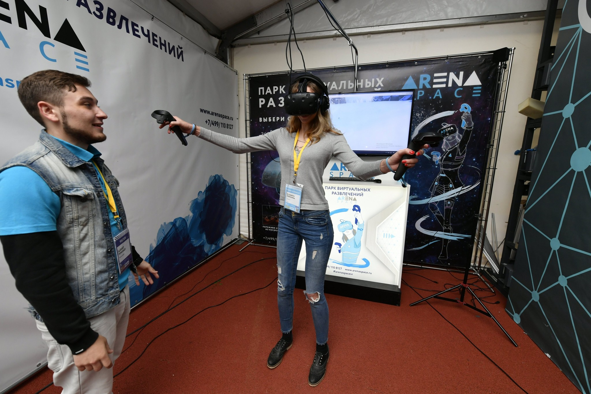 A young scientist tests out a virtual reality mask at the Startup Village.