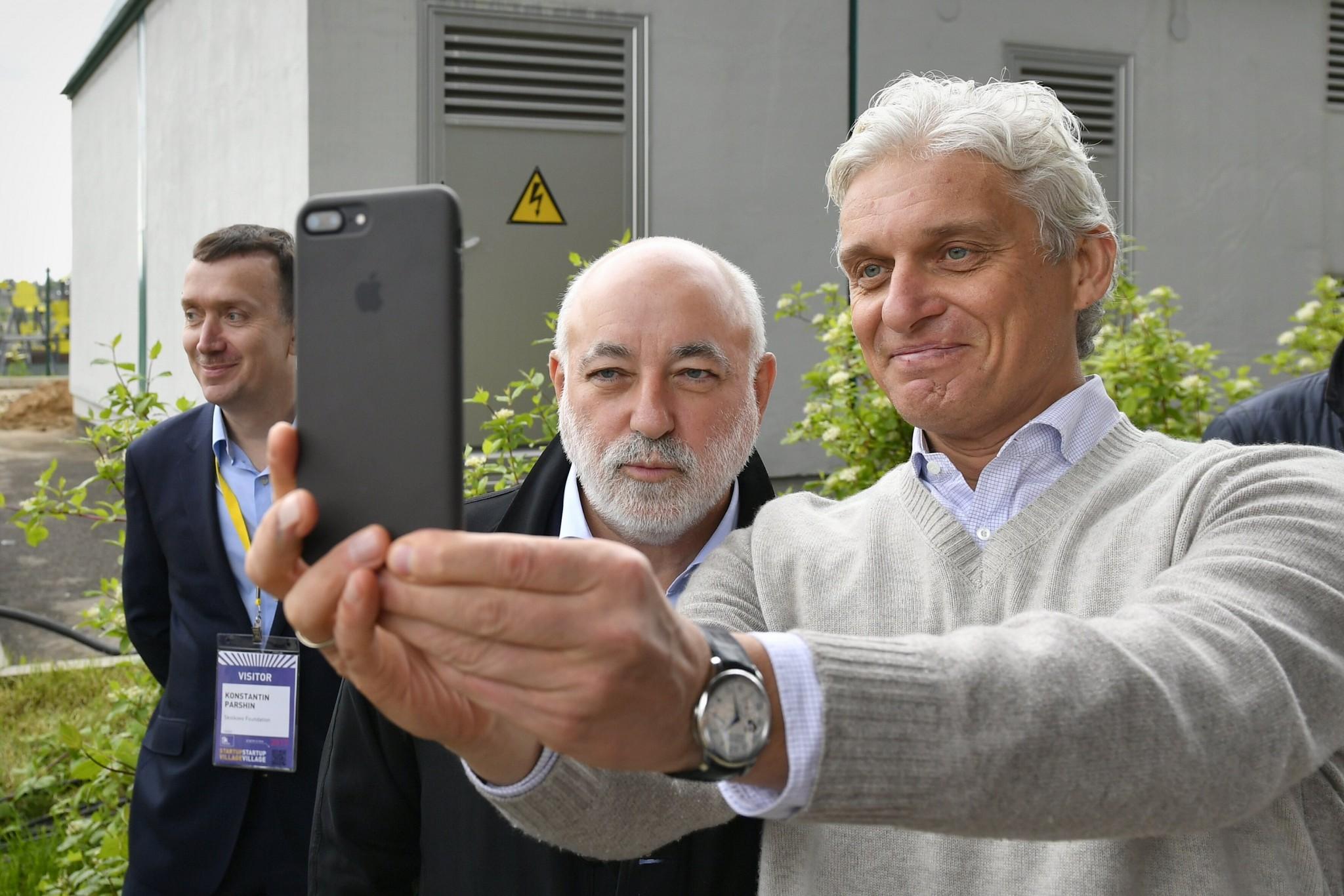 Skolkovo Foundation President Victor Vekselberg and entrepreneur Oleg Tinkov take a selfie together during the Startup Village.