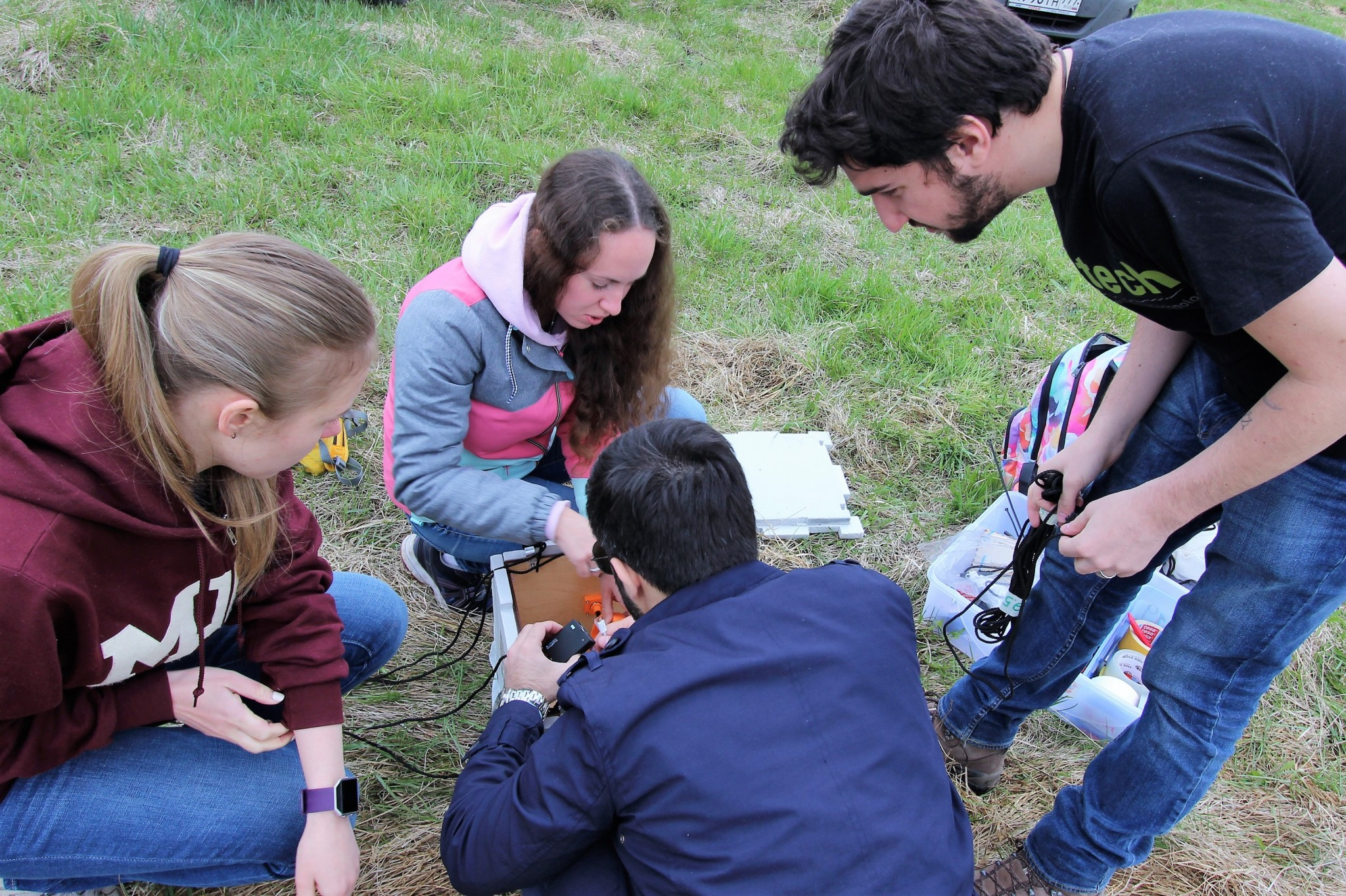 A team of students, including (from left) Anastasia Stelvaga, Olga Danko, Nicola Garzaniti and Raffaele Gradini prepare their payload for launch. Photo: Skoltech.