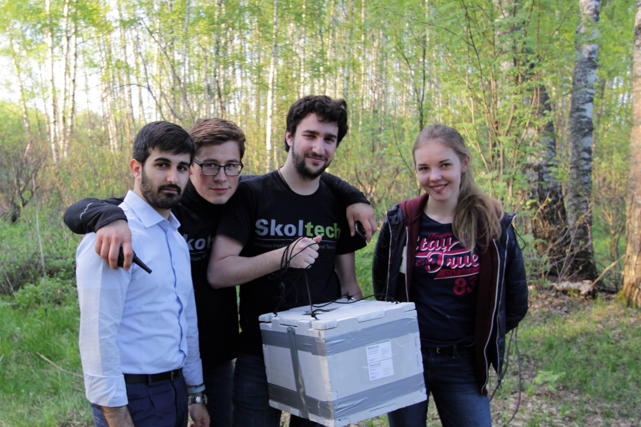 After an epic quest and innumerable mosquito bites, Nicola Garzaniti, Rustam Akhtyamov, Raffaele Gradini and Anastasia Stelvaga pose victoriously with their payload. Photo: Skoltech.