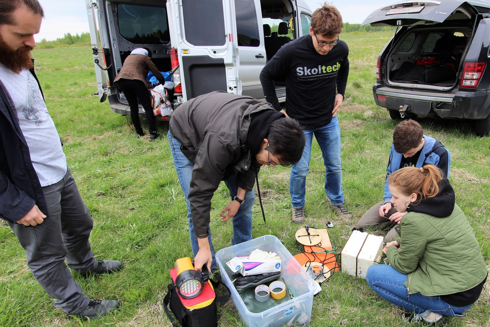 TAs Simone Briatore (left) and Rustam Akhtyamov (middle) help students as they prepare for the launch. Photo: Skoltech.