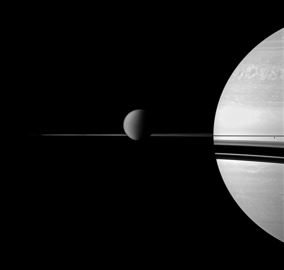 A depiction of Titan with Saturn in the background. Image: NASA/JPL/Space Science Institute.
