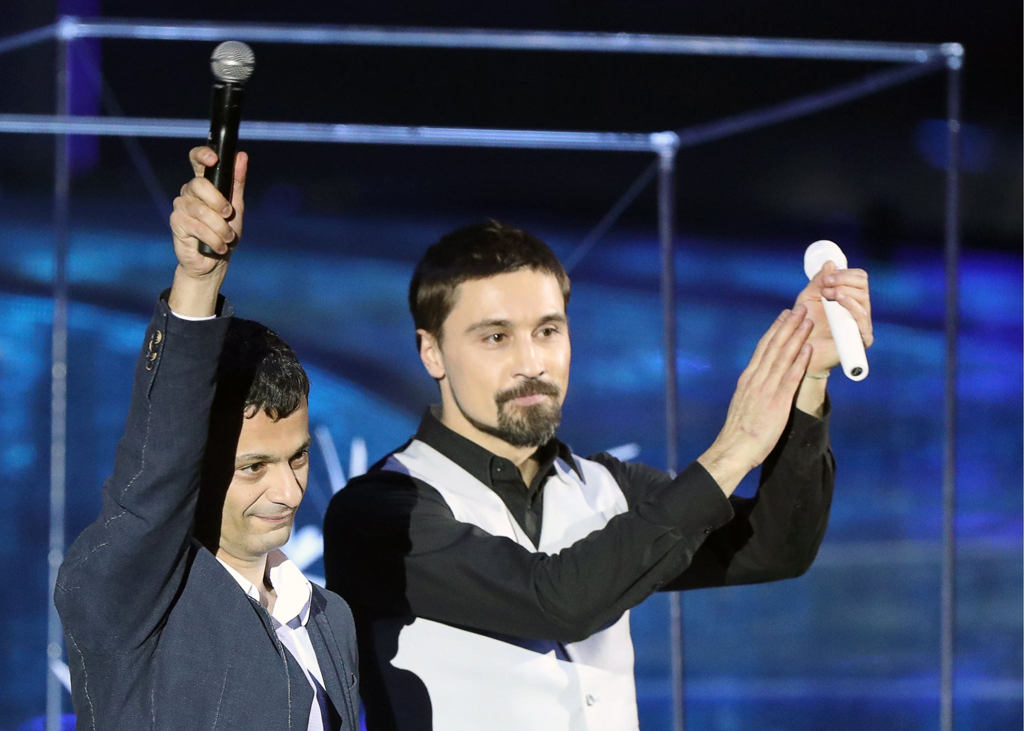 Professor Artem Oganov (left) waves to the audience alongside popstart Dima Bilan during the opening ceremony of the World Festival of Youth and Students in Sochi. Photo: Francesca Nesterenko // Facebook.