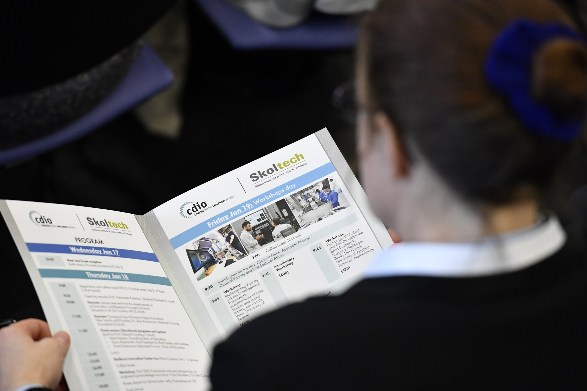 A CDIO participant browses the program of the event. Photo: Skoltech.