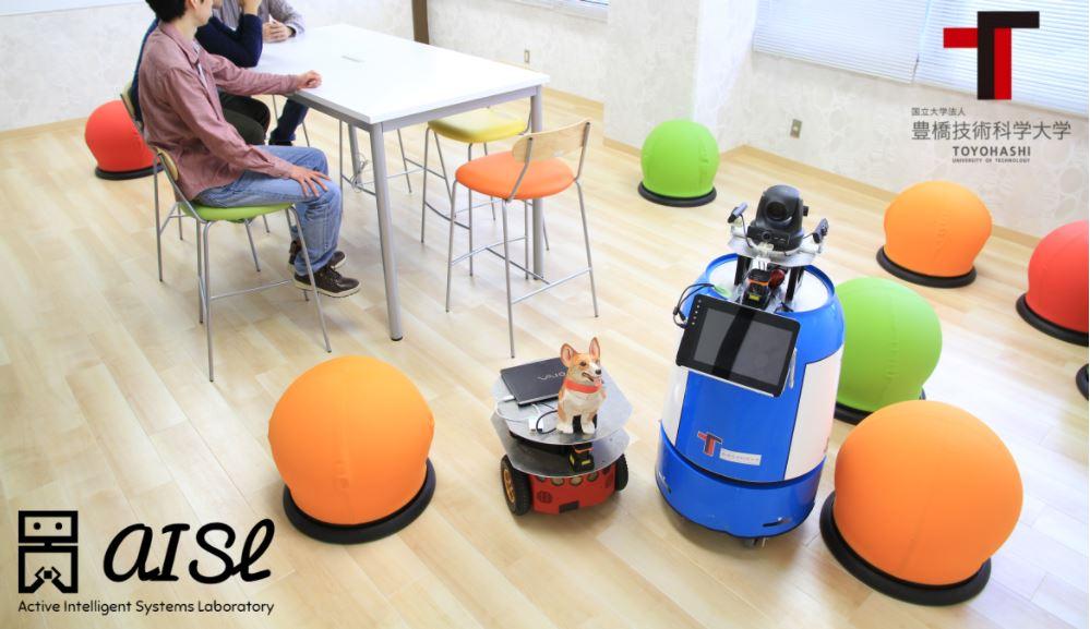 One of Professor Miura's caregiving robots pictured next to a corgi. Photo: Toyohashi University of Technology.