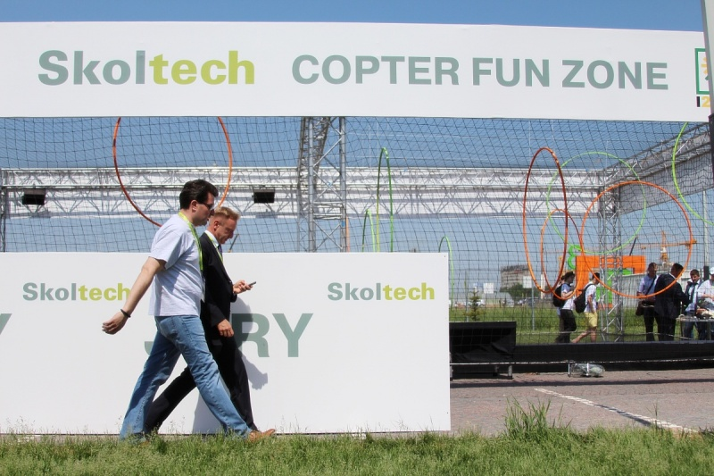 Russian Minister of Education and Science Dmitry Livanov and Alexei Sitnikov, Skoltech VP of Institutional and Resource Development walking past copter arena