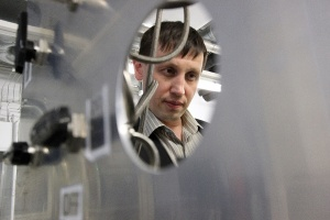 Professor Albert Nasibulin examines a carbon nanotube reactor at the lab he had helped set up at Helsinki University of Technology (nowadays Aalto University) in the early 2000s. Recently, he has moved to Moscow where he leads nanomaterial research and teaches at Skoltech.