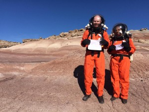 "Divya Shankar (right) and Mikhail Khmelik present the Skoltech logo on ""Mars"""