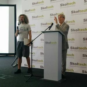 Ivan Bortnik greets the students with the help of a special interpreter - Prof. Konstantin Severinov, director of Skoltech Biomed Center