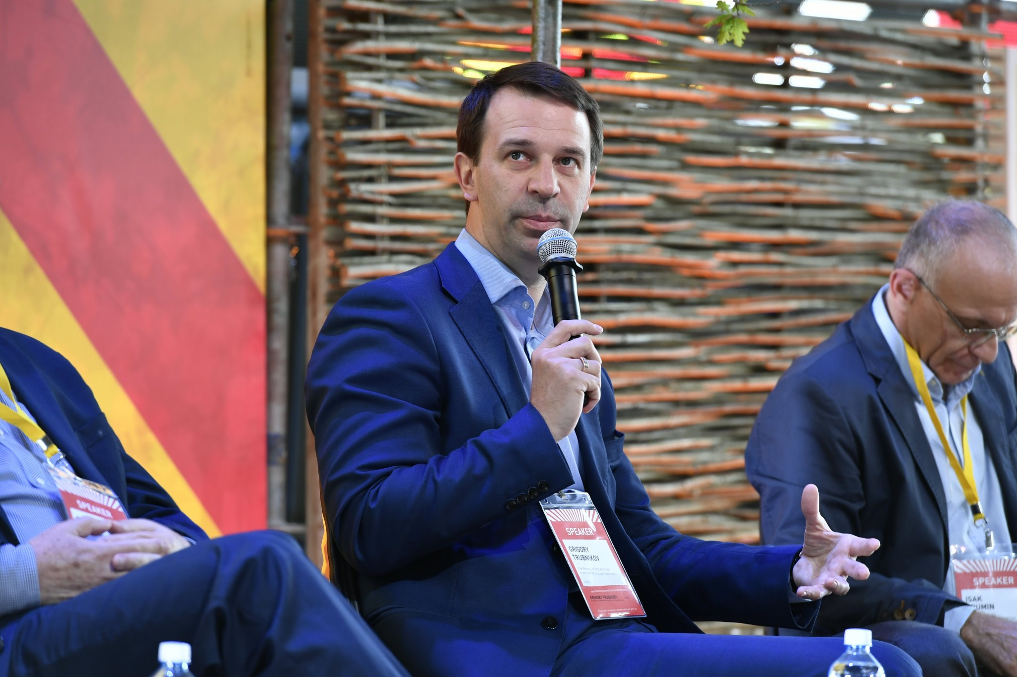 Russian Deputy Education Minister Grigory Trubnikov speaks to a crowd of education enthusiasts at the Startup Village.