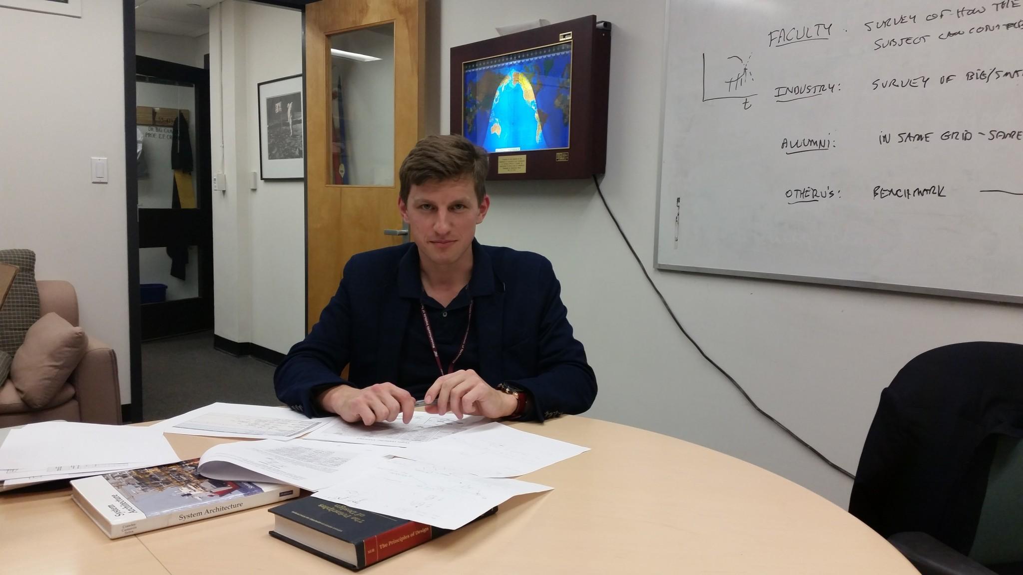 Skoltech PhD candidate Yaroslav Menshenin pictured in the MIT office of his supervisor Edward Crawley, Skoltech's founding president. Photo: Yaroslav Menshenin // Skoltech.