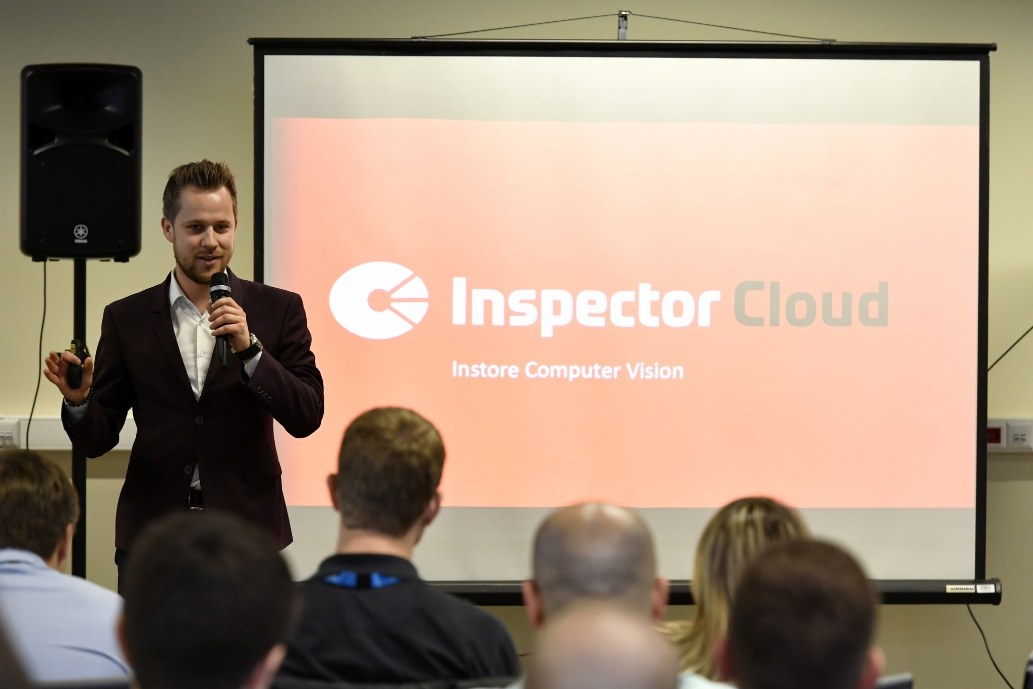 Inspector Cloud CEO Alexander Berenov delivers a presentation on the company's offerings. Photo: Skolkovo