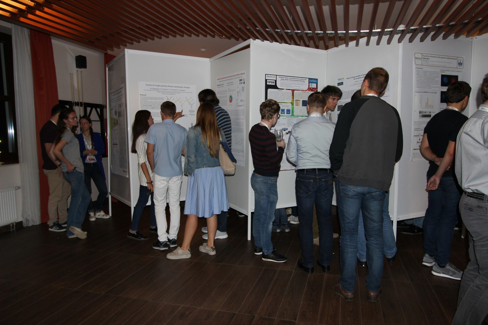 A candid shot of one of the captivating poster sessions that spilled late into the evening. Photo: Skoltech.