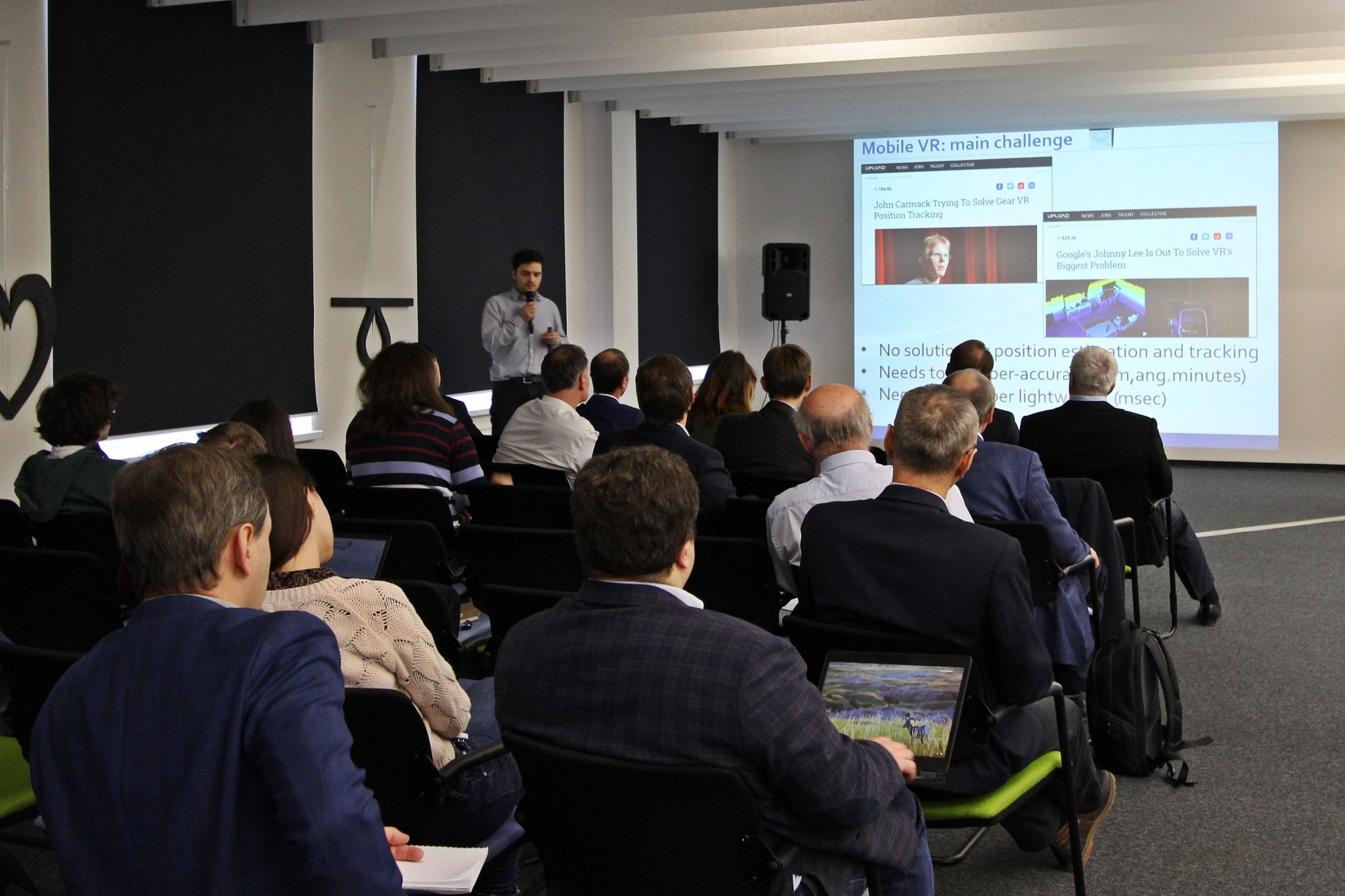 Skoltech Professor Victor Lempitsky presents on his project. Photo: Skoltech.
