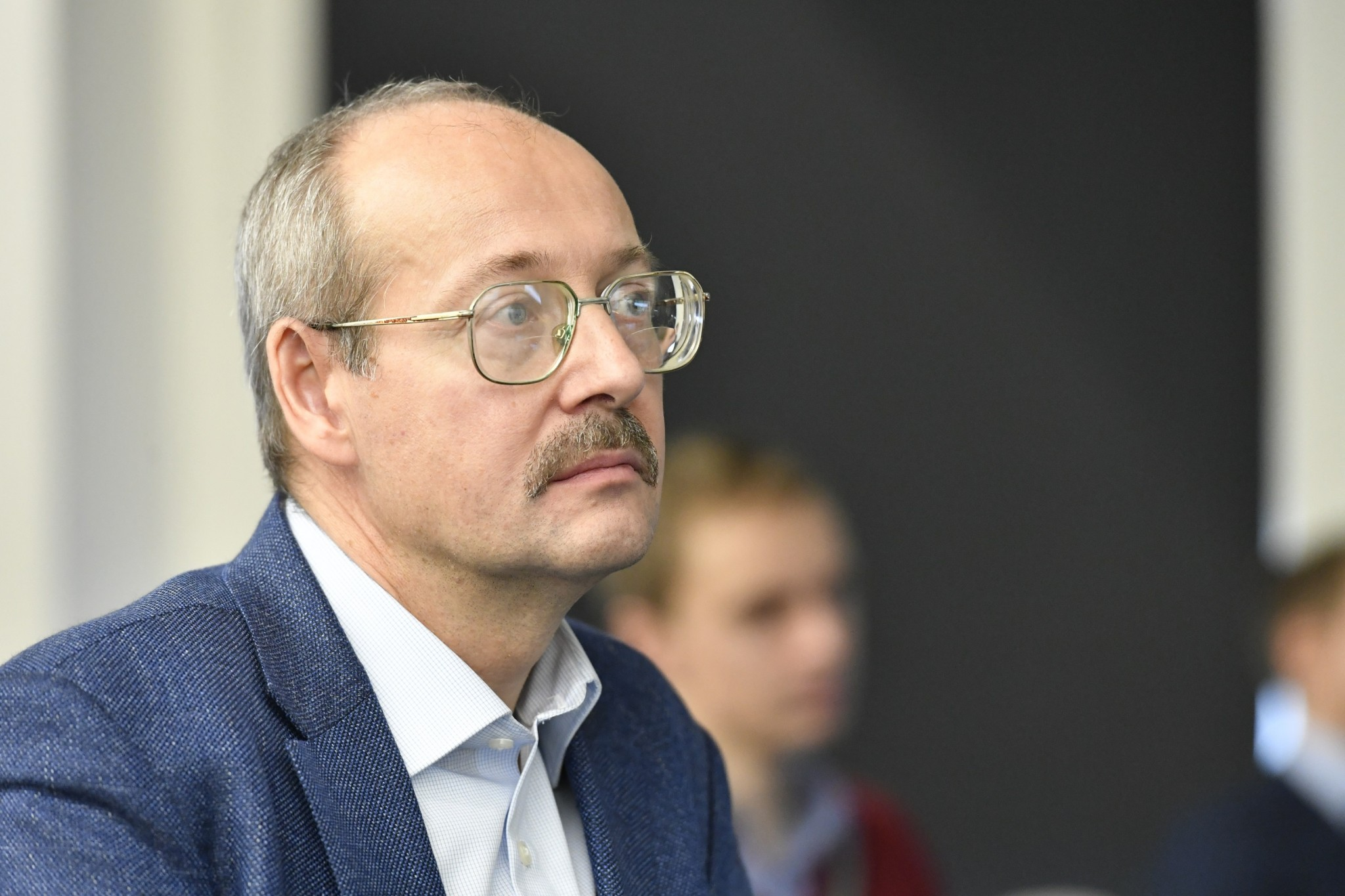 Skoltech Professor Alexey Nikolaev listening to a presentation. Photo: Skoltech.