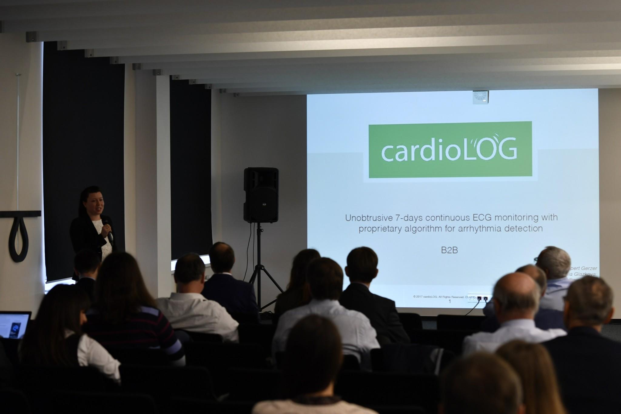 A team presents on a technology aimed at detecting irregular heartbeats. Photo: Skoltech.