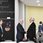 Skolkovo Foundation President Victor Vekselberg (center-left) greets Skoltech President Alexander Kuleshov ahead of the foundation council meeting on Friday. Photo: Sk.ru.