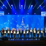 Young scientists, including four Skoltech employees, pose with their prizes on the stage of the State Kremlin Palace.
