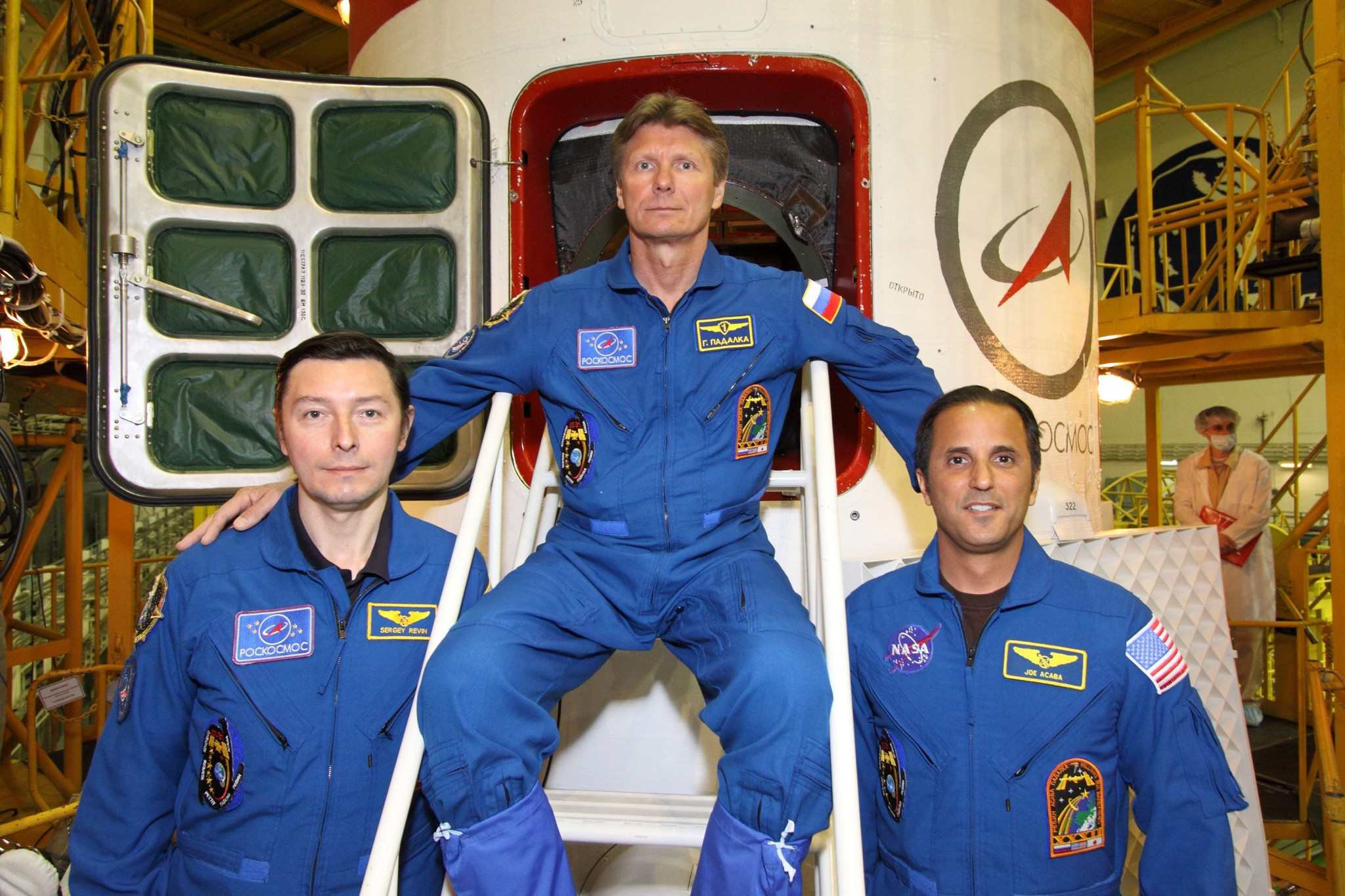 Revin and his crewmates Gennady Padalka and Joe Acaba pictured in front of the  hitchway to their Soyuz. Photo: NASA.