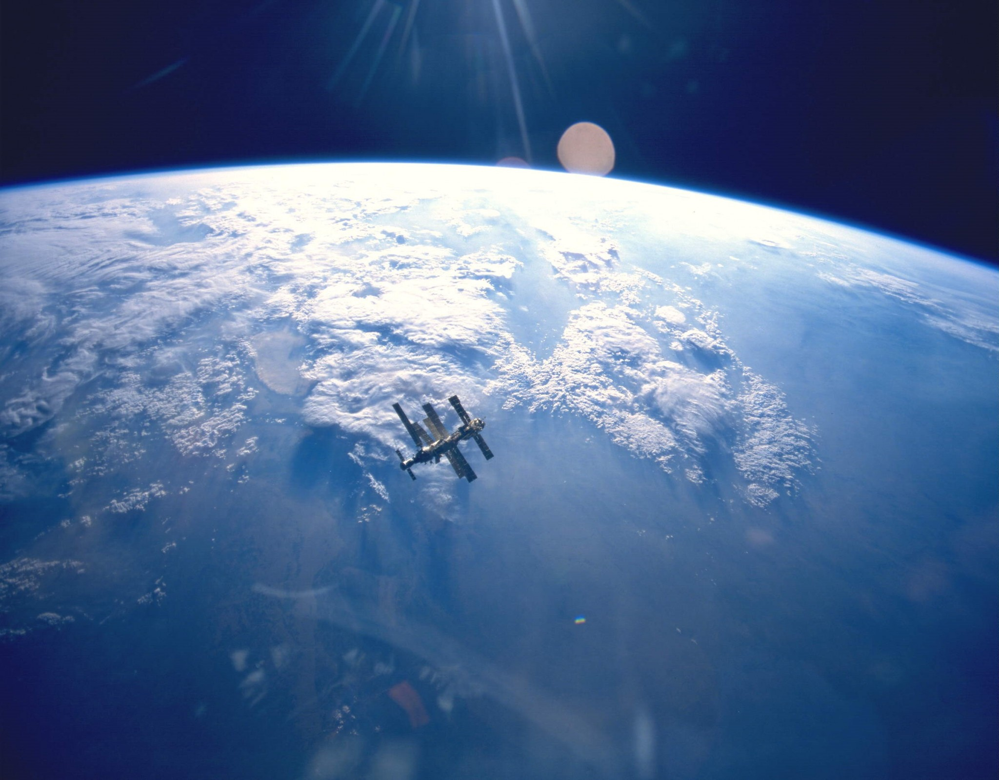 Earth, as viewed from space, with the Shuttle Mir in the foreground. Photo: NASA.