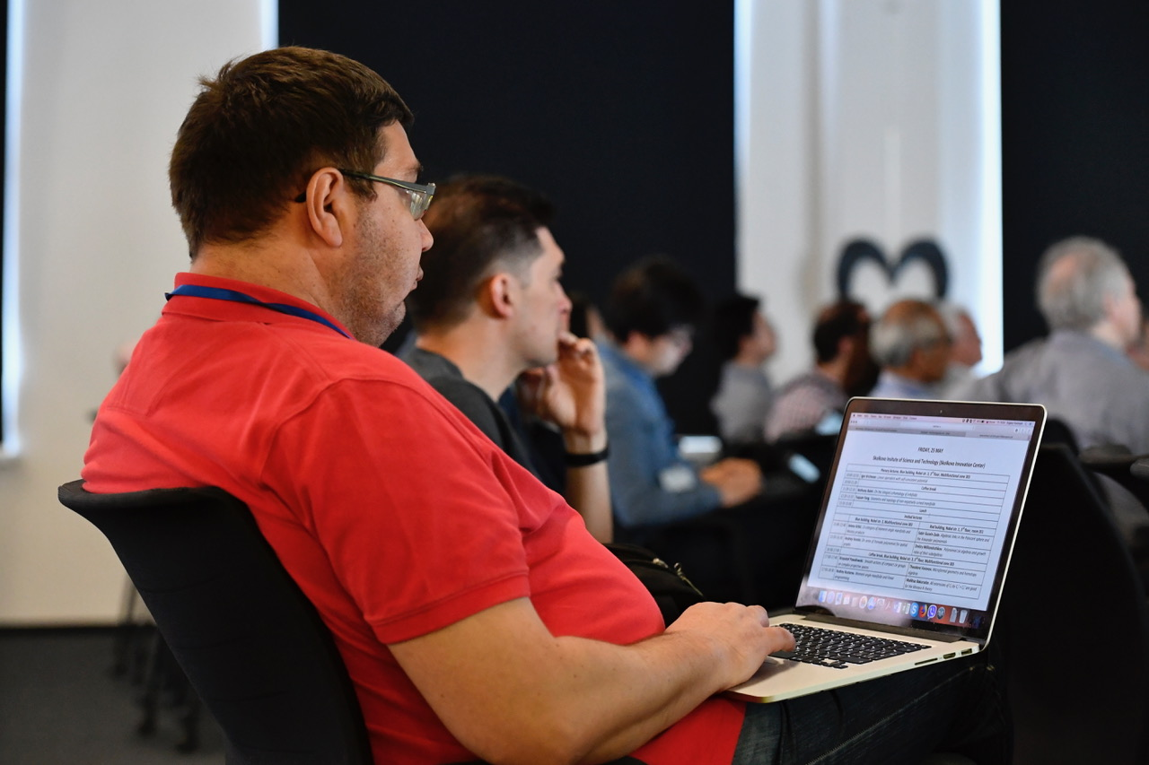 An attendee peruses the conference's expansive agenda. Photo: Skoltech.
