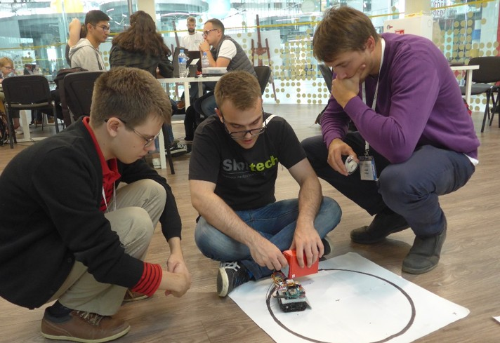 Students prepare a self-driving inventory robot for the Innovation Workshop's Internet of Things (IoT) exercise.