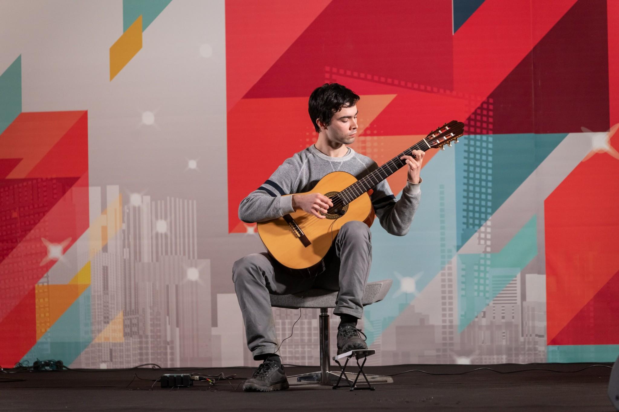 "Image: Evgenii Anikin playing Isaac Ibanez's ""Asturias"""
