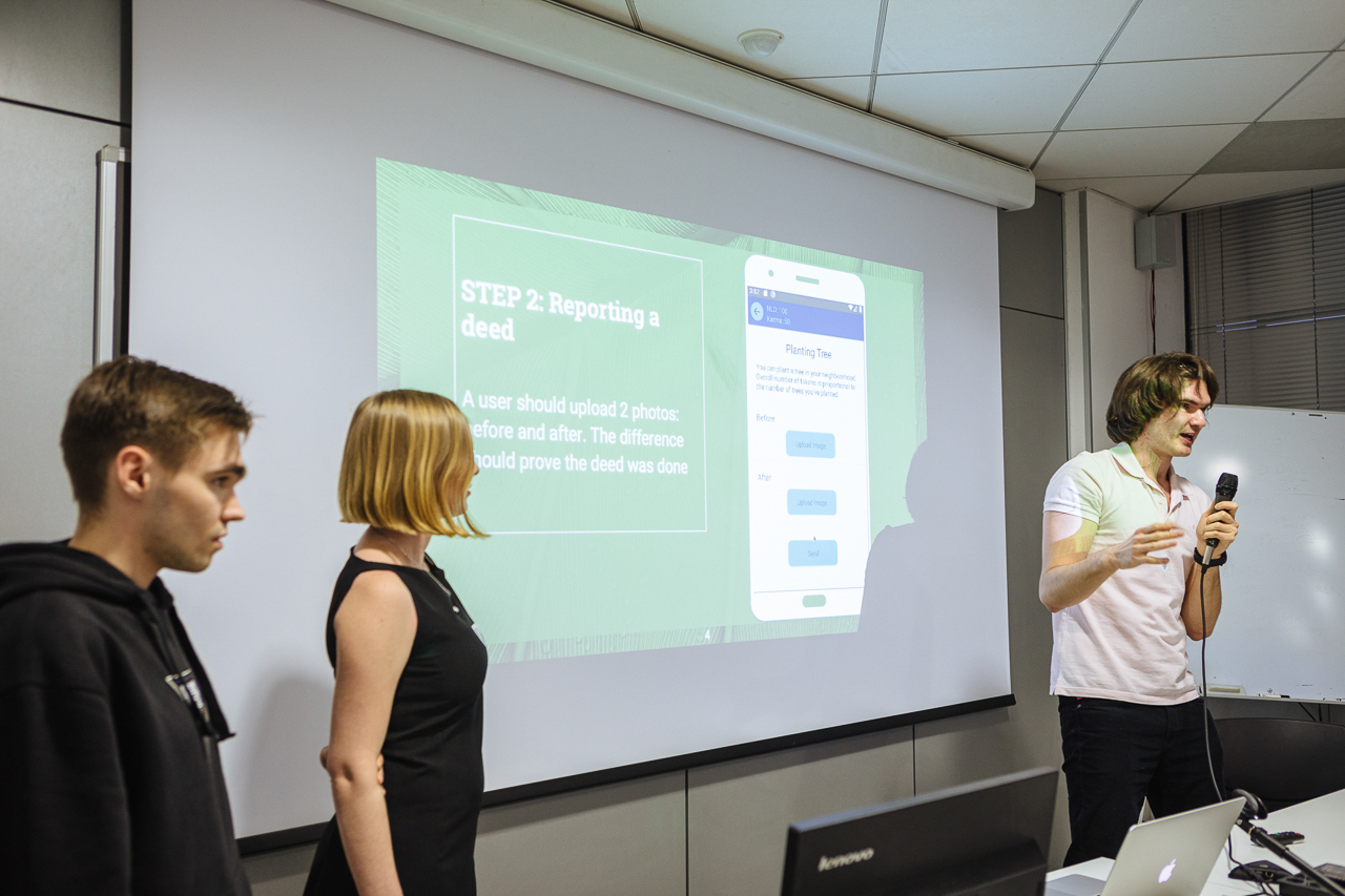 Final presentation – Vlad, Lyubov and Ivan (with mic), Wild Hunchers team, at University of the Republic of San Marino
