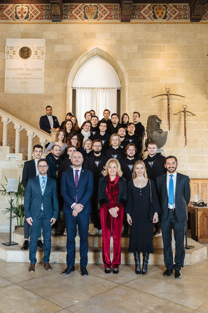 J9 – Skoltech students and Nulan team with highest officlas of San Marino (first row, from the left): Fabio Righi, the Minister of Industry and Technological Research, Luca Boschi and Mariella Mularoni the Captains Regent, Ellen Quirk Founder & CEO of Kismet Impact Capital, Samir Mastaki, CEO Nuland; At the parliament of the Republic of San Marino