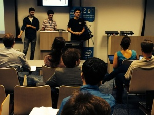 Vahe Tahmazyan and teammates Almir Dzhumaev and Alexander Vidiborskyi present their project at Intel