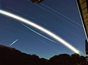 Satellite flare, Moon trail and star trails. Image courtesy of MomentsForZen