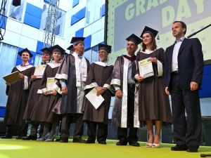 """Winners of the """"Outstanding Thesis Awards"""" on stage with Russian first deputy Prime Minister Arkady Dvorkovich."""