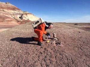 Crew engineer Mikhail Khmelik taking soil samples