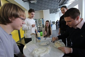 """Cooking cheese during the """"Science and Cooking"""" class."""