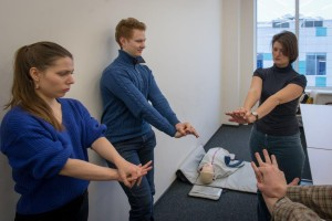 "Learning to perform CPR during ""First aid and emergency medicine"" class."