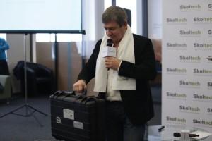 Skolkovo senior Vice President Alexander Chernov with a special gift.