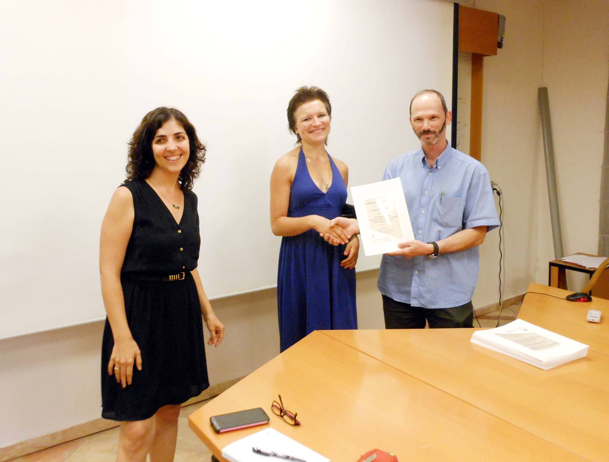 Anna Shmelkova receives her diploma from the program director, Prof. Nir Ohad