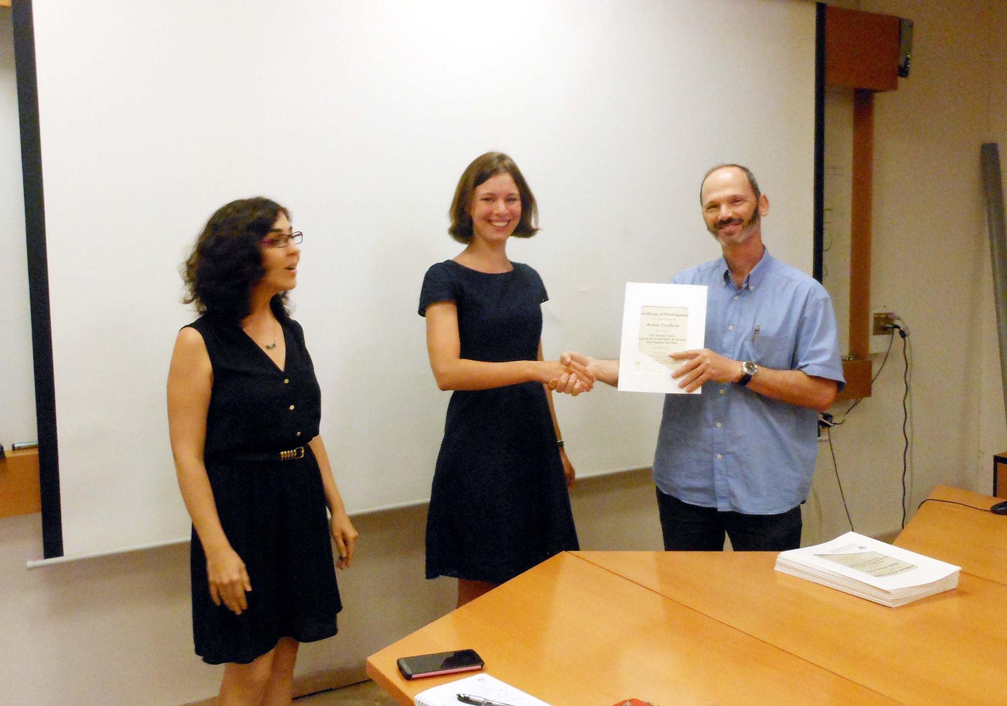 Ksenia Tsvetkova receives her diploma from the program director, Prof. Nir Ohad